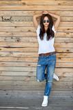 Beautiful young stylish woman in sunglasses