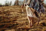 woman legs in native indian american boho dress walking in windy - 118843122
