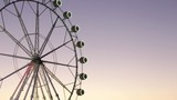 Ferris wheel in Bilbao at sunset.