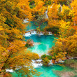 Autumn view on waterfalls and lakesl with turquoise water and g