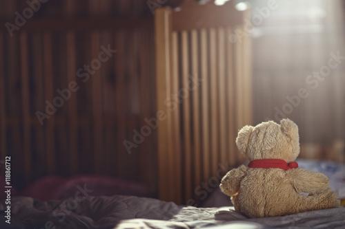 Teddy bear in an empty child's room