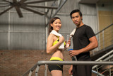 Cheerful asian couple after training in gym