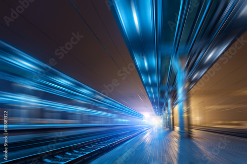 In de dag Tunnel Railway station at night with motion blur effect. Railroad