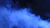 smoke clouds. Smoke billowing over a black background.