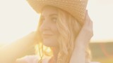 girl in a straw hat at sunset