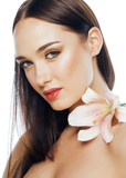 young attractive lady close up with hands on face isolated flower lily brunette spa nude makeup