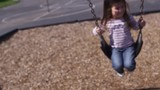 Little children playing on swings - 4K