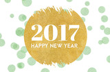 Happy new year 2017 word on gold circle glitter on light green d
