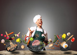 Fototapety Chef juggling with vegetables and other food in the kitchen