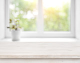 Fototapety Wooden table on defocused summer window with flower pot background