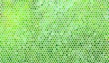 Résumé de la mosaïque de pierre dans des tons verts avec joints blancs.