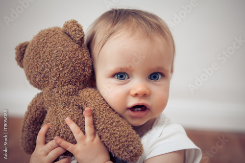 Poster baby with a teddy