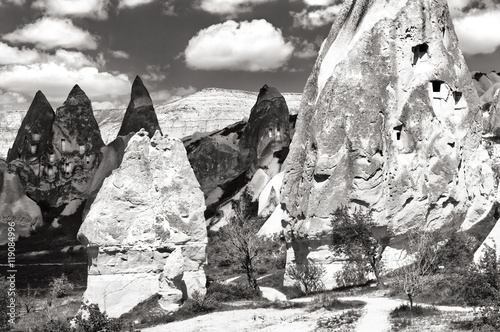 Poster Fantastic black and white landscape with cone-shaped rocks .