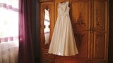 Wedding dress hanging in the room