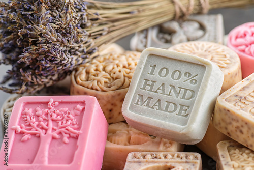 set of handmade soaps with lavender bunch, product of cosmetics and body care