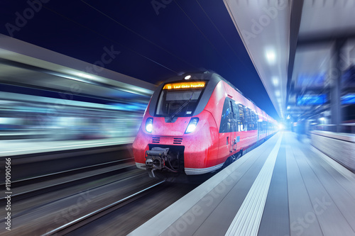 Plakát Modern high speed red passenger train at night