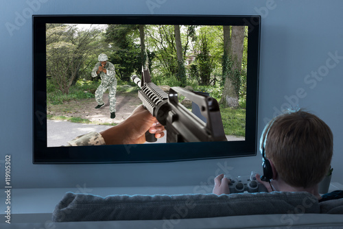 Boy Playing Action Game On Television Poster