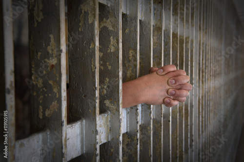 Hands of Prisoner Coming from Cell Poster