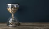 Sanduhr mit Euromünzel - Zeit ist Geld - 119125952