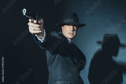 Vintage film noir 1940s gangster shooting with gun. Poster