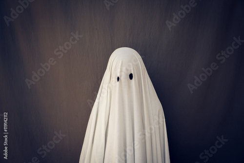 White Ghost on a gray background. Halloween holiday Poster