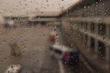 Raindrops on window glass blur background