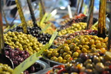 Marinated olives on street market closeup with selective focus - 119179594