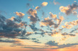 Sunrise sky with gentle colors of soft clouds and sun rays