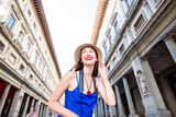 Young female traveler near famous Uffizi museum in Florence. Vacation in Italy