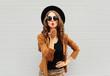 Fashion lifestyle portrait woman sends air sweet kiss wearing a