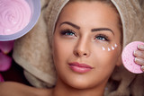 Pretty young woman with facial mask
