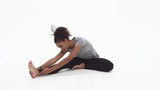 Young African American woman stretching