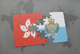 puzzle with the national flag of hong kong and san marino on a world map background.