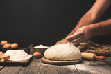 Men hands sprinkle dough flour close up