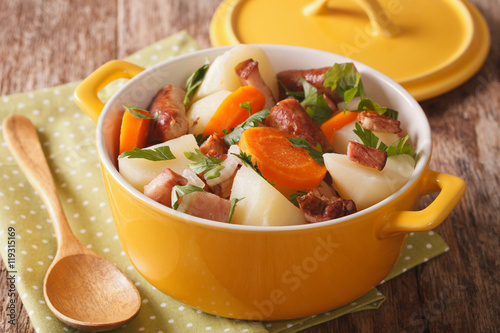 Traditional Irish dish is coddle with sausages, bacon and vegetables Poster