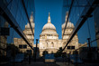 St Paul's cathedral seen from a narrow alley enclosed by glass buildings and reflecting in the shiny surface at morning dawn