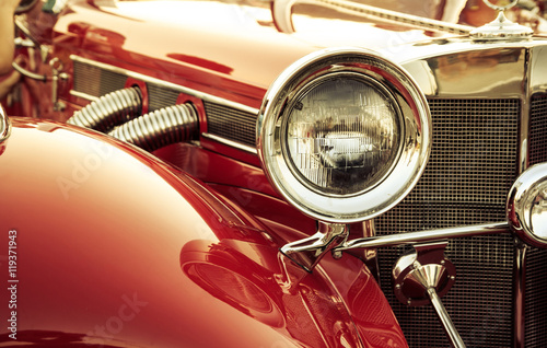 Zdjęcia na płótnie, fototapety na wymiar, obrazy na ścianę : Old classic car front detail, oldtimer front lamp