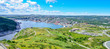 Panoramic views with bight blue summer day sky with puffy clouds over the harbour and city of St. John's Newfoundland, Canada.