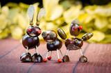 three chestnut figures