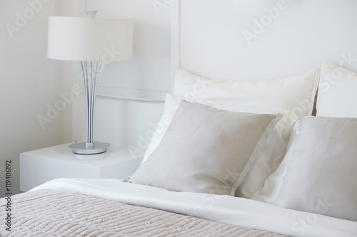 Plagát Light gray pillow setting on bed in nice vibe bedroom modern interior style