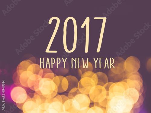 Poster 2017 happy new year on vintage blur festive bokeh light backgrou