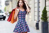 Young beautiful woman with shopping bags in the ctiy- Let