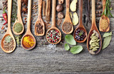 Herbs with spices on a wooden background - 119419901