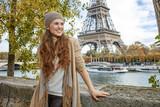 smiling elegant woman tourist having excursion in Paris, France - 119440796