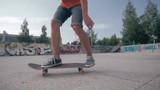 Skateboarder doing tricks in a city. HD.