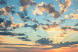 Sunrise sky, gentle colors of soft clouds and sunshine with rays