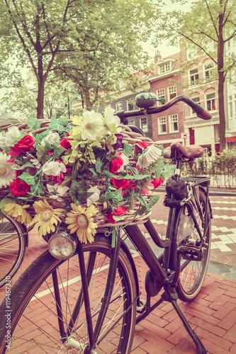 Zdjęcia na płótnie, fototapety na wymiar, obrazy na ścianę : Retro styled image of a Dutch bicycle in Amsterdam