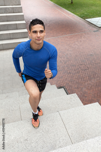 Young athlete training climbing stairs