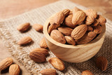 Fototapety Almond snack fruit in wooden bowl