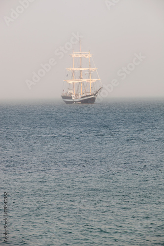 Mysterious sailing ship surrounded fog - 119544362